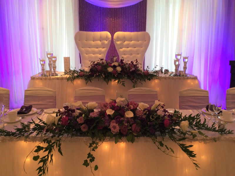 head table throne chairs with flowers